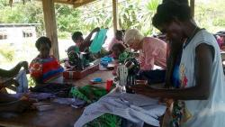 Anne and her Bougainville friend at a sewing workshop