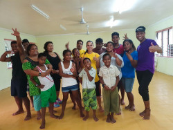 Roi Burnett middle and the Zumba class with instructor Aberaam on far right.